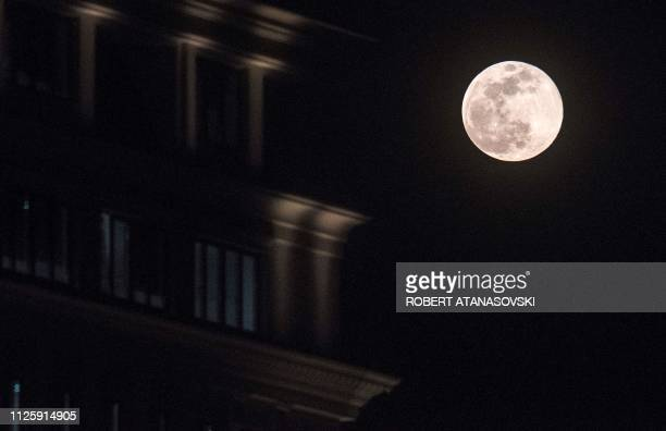 A Super Snow Moon rises behind a building in Skopje on February 19 2019