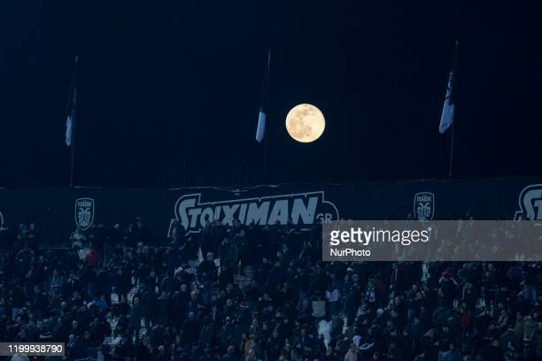 Super snow moon the full luna supermoon over Toumba Football Stadium home of FC PAOK during the match soccer game for the Greek Super League PAOK v...