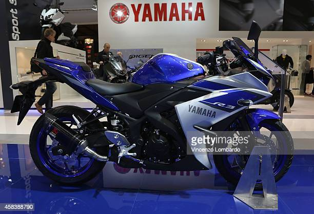 Super Sports model YZFR3 is displayed at YAMAHA booth during the EICMA 2014 72nd International Motorcycle Exhibition at Fiera Milano on November 4...
