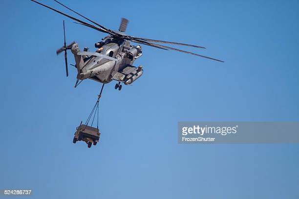 ch-53e super stallion (sikorsky) helicopter carrying military humvee - raf stock pictures, royalty-free photos & images