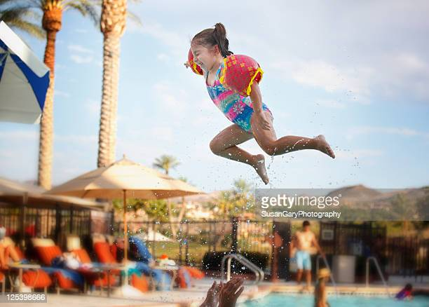 Super toddler girl flying in air