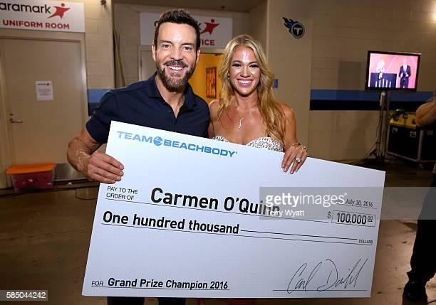 Super Trainer Tony Horton and Beachbody Challenge Winner Carmen O'Quinn pose backstage during the 2016 Beachbody Coach Summit Closing Celebration at...