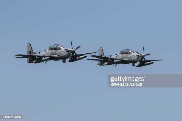 Super Tucano military aircrafts fly over targets during a drill by the Lebanese Airforce in the northern Lebanese village of Hamat on April 11 2019
