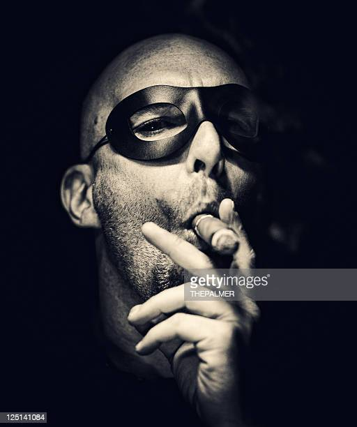 super villain smoking in the dark