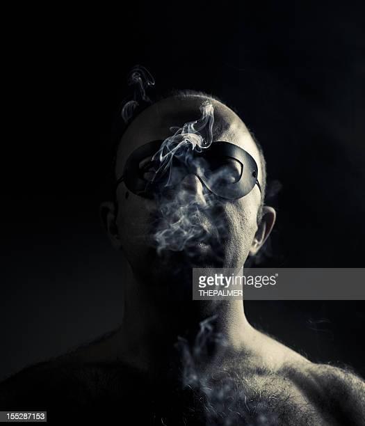 super villain smoking in the dark