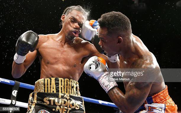 Super welterweight boxer Jermell Charlo connects with a punch on John Jackson during the eighth round of their fight for a vacant WBC title at The...