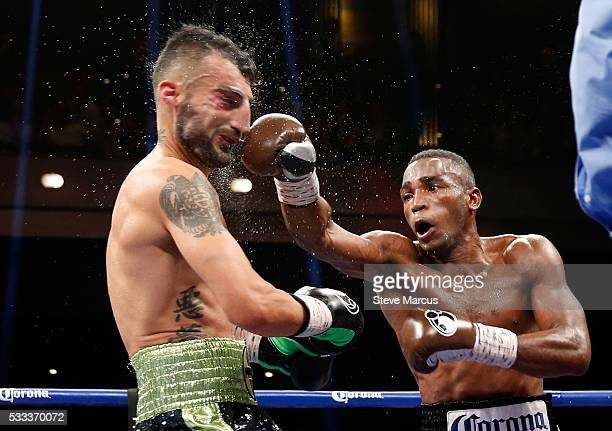 WBA super welterweight champion Erislandy Lara connects with a punch on Vanes Martirosyan during their title fight at The Chelsea at The Cosmopolitan...