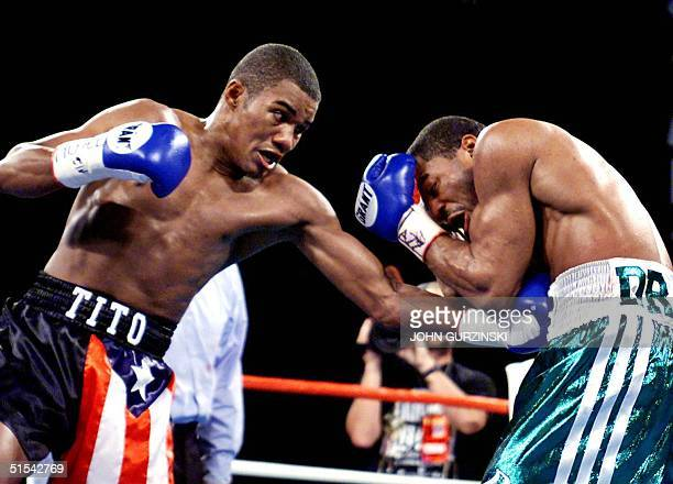 Super Welterweight Champion Felix Trinidad of Cupey Puerto Rico lands a left to the body of WBA Champion David Reid of Philadelphia PA in the 10th...