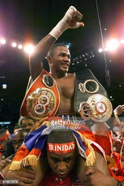 Super Welterweight Champion Felix Trinidad of Puerto Rico is lifted in the air after defeating opponent William Joppy of Silver Spring, Maryland....