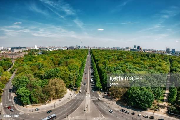 super wide panorama of Tiergarten with Berlin Skyline under blue sky