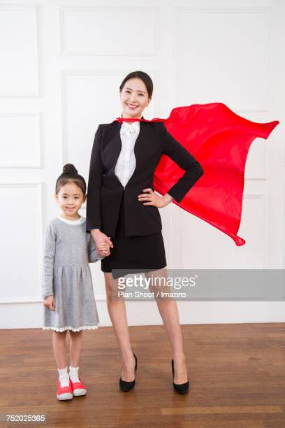 super working mom with her daughter - super mom stock photos and pictures