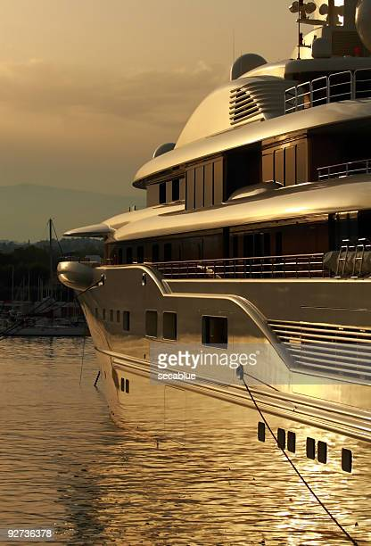 super yacht in port at sunset - luxury yacht stock pictures, royalty-free photos & images