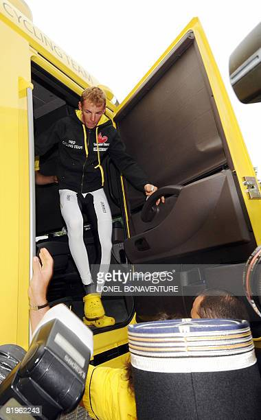 Super-Besse and Bagneres-de-Bigorre winner Italian Riccardo Ricco leaves his team bus, surrounded by French gendarmes, on July 17 2008 in Lavelanet,...