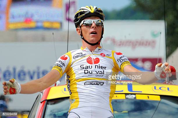 Super-Besse winner, Italian Riccardo Ricco jubilates on the finish line, on July 13 at the end of the 224 km ninth stage of the 2008 Tour de France...