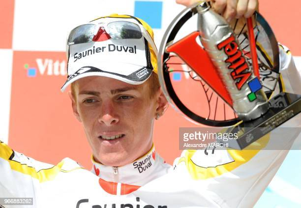 Super-Besse winner, Italian Riccardo Ricco waves on the podium, on July 13 at the end of the 224 km ninth stage of the 2008 Tour de France cycling...