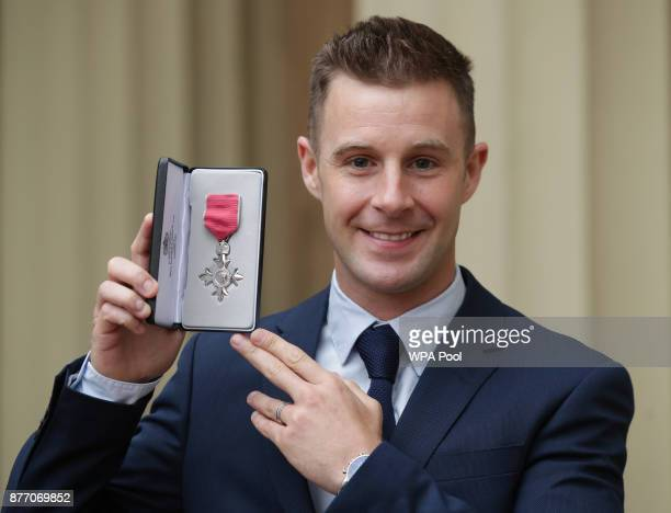 Superbike world champion Jonathan Rea poses after being presented with an MBE by the Duke of Cambridge during an Investiture ceremony at Buckingham...