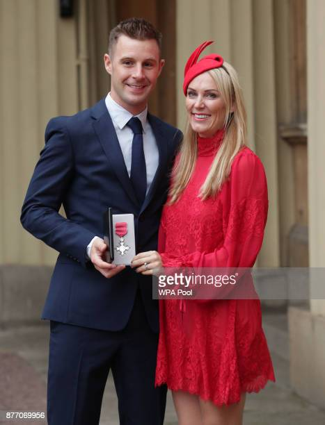 Superbike world champion Jonathan Rea poses with his wife Tatia after being presented with an MBE by the Duke of Cambridge during an Investiture...