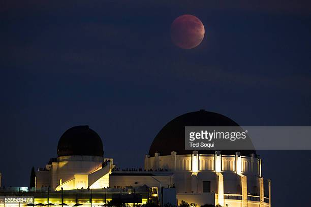 Superbloodmoon rising over the Griffith Park Observatory in Los Angeles This is a rare occurrence where a full moon becomes a superman during a...