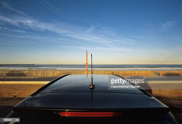 supercar at the beach - sunset sky copyspace - marcoventuriniautieri stock pictures, royalty-free photos & images
