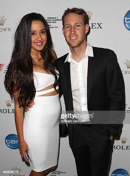 Supercars Championship driver David Reynolds and Tahan Lew Fatt pose during the GP@23 Official Australian Grand Prix Party at Club 23 on March 11...