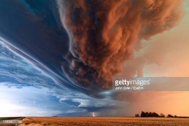 a supercell thunderstorm with dramatic clouds and lightning at sunset near st. francis, kansas. - cyclone stock pictures, royalty-free photos & images