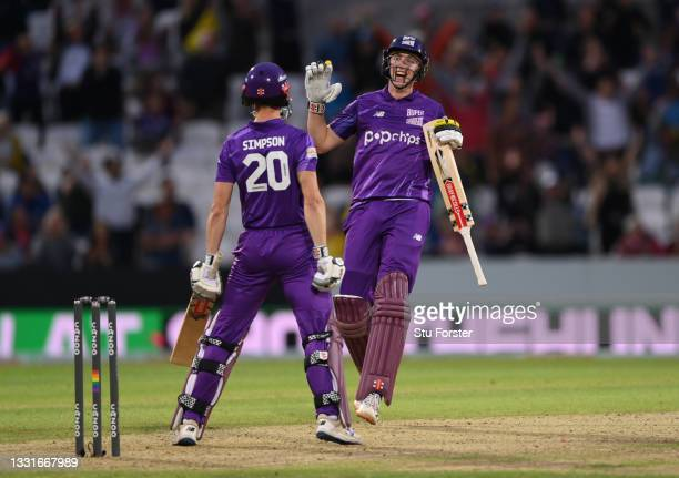 Superchargers batter Harry Brook celebrates victory with John Simpson during The Hundred match between Northern Superchargers Men and Oval...