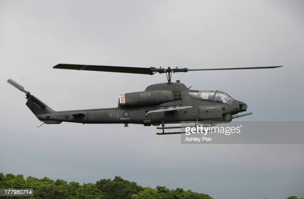AH1 'SuperCobra' attack Helicopter flies over the drill area during a military drill on August 26 2013 in Taichung Taiwan This is an annual military...