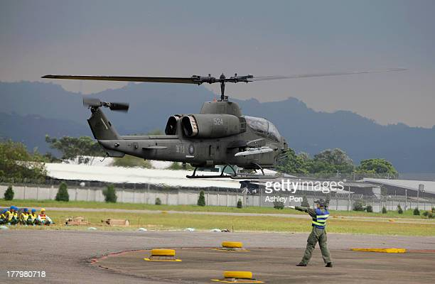 AH1 'SuperCobra' landing to be rearmed during a military drill on August 26 2013 in Taichung Taiwan This is an annual military drill in preperation...
