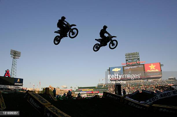 Supercross riders in action The Amp'd Mobile/AMA Supercross 2006 Series opener took place at Angel Stadium in Anaheim California on January 7 2006