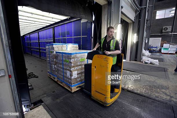 Superdrug employees unload a shipment of Optimum Swiss apple skin treatment which will go on sale for 999 GBP on August 31 2010 in Dunstable England...