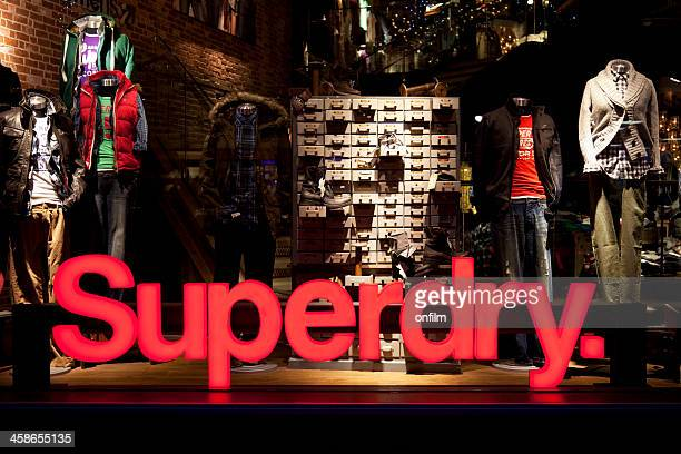 Superdry clothing store shop window, sign and logo