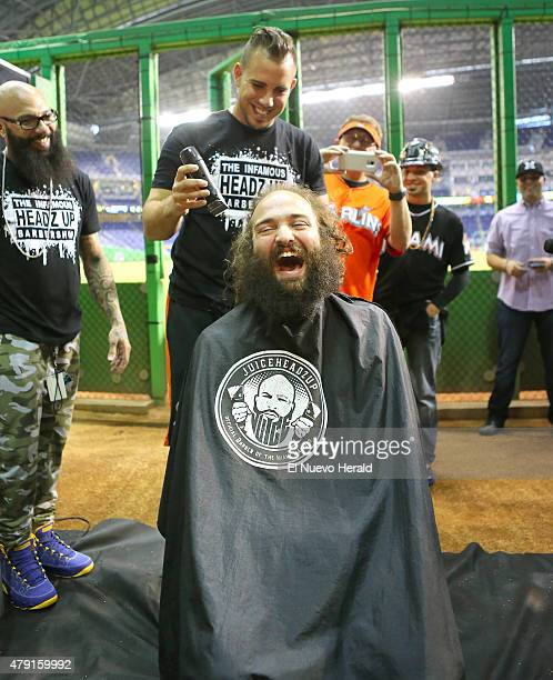 """Superfan Andres Salgado """"The Jose Guy"""" receives a hair cut from Miami Marlins pitcher Jose Fernandez, as the team's official barber of the Marlins..."""