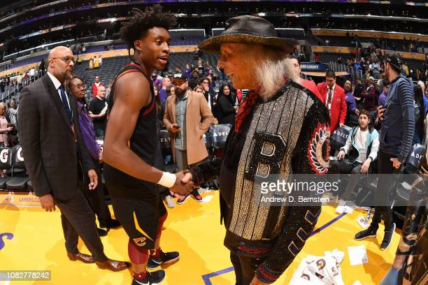 Superfan James Goldstein and Collin Sexton of the Cleveland Cavaliers shake hands after the game against the Los Angeles Lakers on January 13 2019 at...