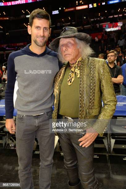 Superfan James Goldstein and Tennis player Novak Djokovic talk after the game between the Golden State Warriors against the LA Clippers on October 30...