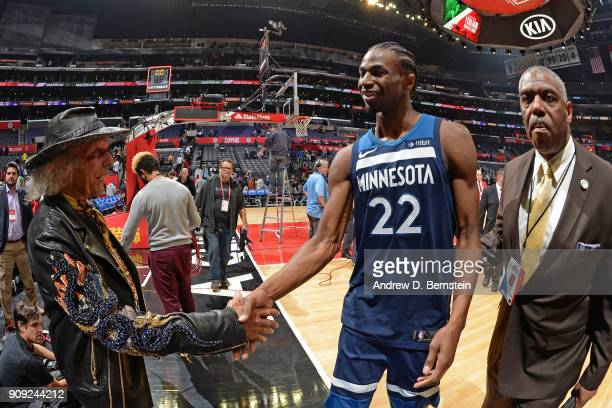 Superfan James Goldstein shakes hands with Andrew Wiggins of the Minnesota Timberwolves after the game against the LA Clippers on January 22 2018 at...