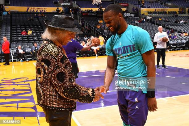 Superfan James Goldstein shakes hands with Kemba Walker of the Charlotte Hornets before the game against the Los Angeles Lakers on January 5 2018 at...