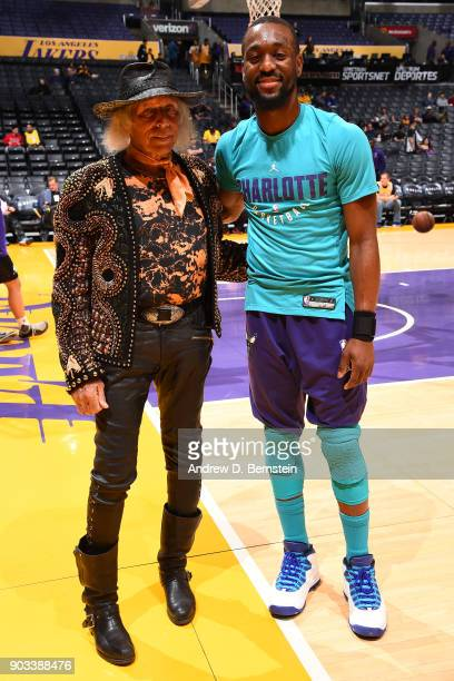 Superfan James Goldstein shakes poses for a photo with Kemba Walker of the Charlotte Hornets before the game against the Los Angeles Lakers on...