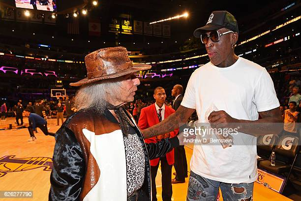 Superfan James Goldstein talks to Former NBA player Dennis Rodman before the Golden State Warriors game against the Los Angeles Lakers on November 25...