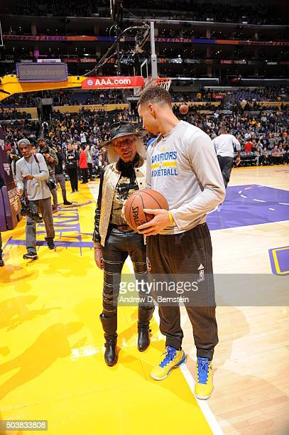 NBA superfan James Goldstein talks to Stephen Curry of the Golden State Warriors before the game against the Los Angeles Lakers at STAPLES Center on...