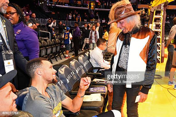 Superfan James Goldstein talks to Stephen Curry of the Golden State Warriors before the game against the Los Angeles Lakers on November 25 2016 at...