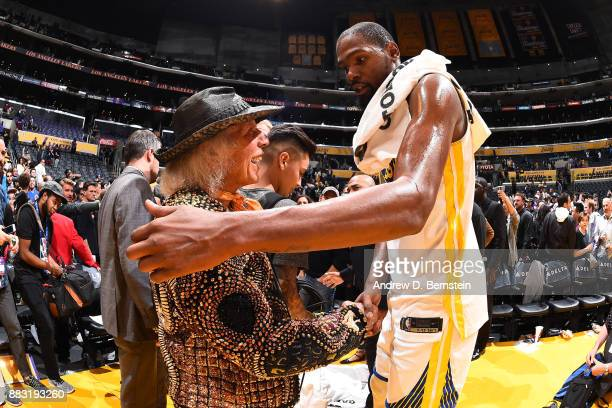 NBA superfan James Goldstein talks with Kevin Durant of the Golden State Warriors after the game against the Los Angeles Lakers on November 29 2017...
