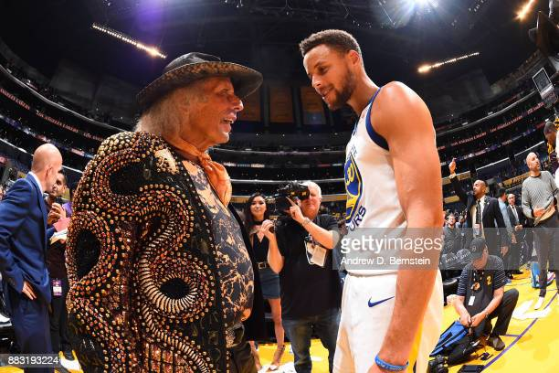 NBA superfan James Goldstein talks with Stephen Curry of the Golden State Warriors after the game against the Los Angeles Lakers on November 29 2017...