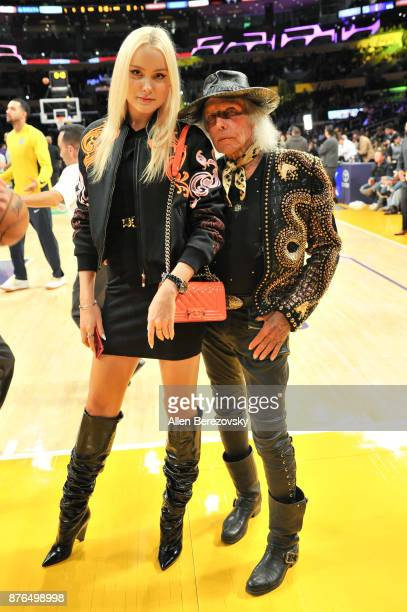 NBA superfan Jimmy Goldstein and a guest attend a basketball game between the Los Angeles Lakers and the Denver Nuggets at Staples Center on November...