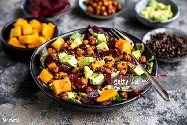 superfood salad, avocado, beetroot, roasted chickpea, sweet potatoe, beluga lentil and blood orange - salad stock pictures, royalty-free photos & images