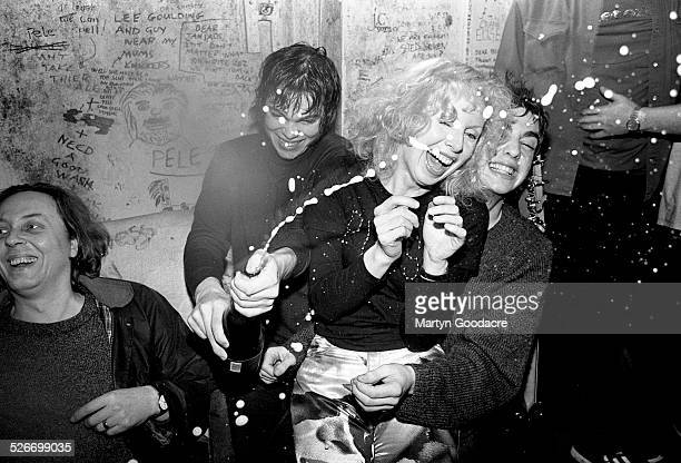 Supergrass backstage at Moles Club, Bath, United Kingdom, 1995. Chris Hufford is far left, Gaz Coombes is opening champagne and Danny Goffey is on...