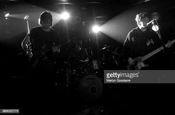 Supergrass perform on stage, United Kingdom, 1998. L-R Gaz Coombes, Danny Goffey, Mick Quinn.
