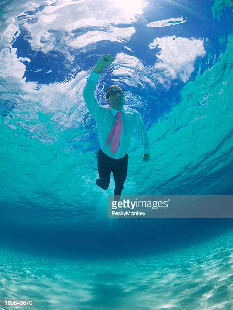 Superhero Businessman Swims Underwater Blue Sky