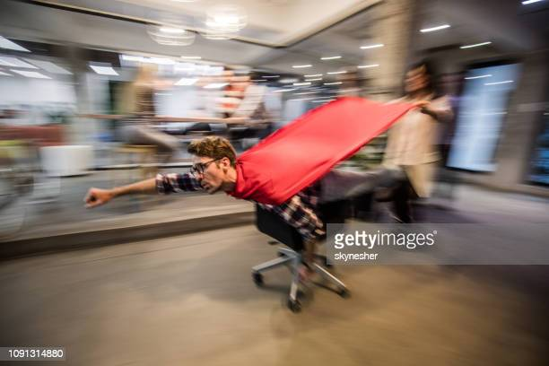 superhero in the office! - superhero stock pictures, royalty-free photos & images