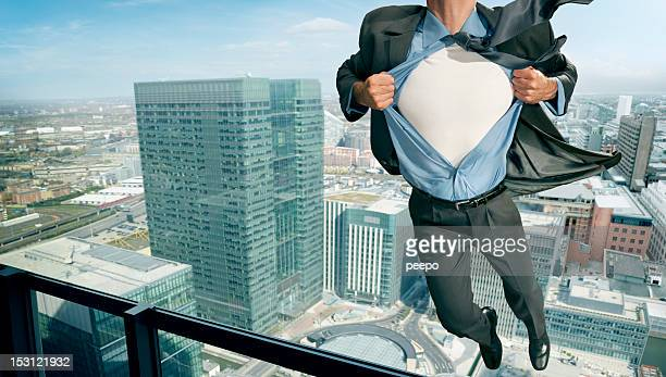 superhero pulling open shirt in mid air - fully unbuttoned stock pictures, royalty-free photos & images
