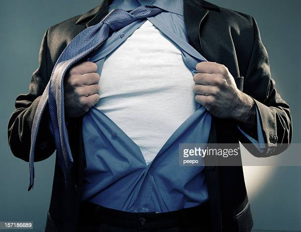 superhero pulling open shirt in mid air - all shirts stock pictures, royalty-free photos & images